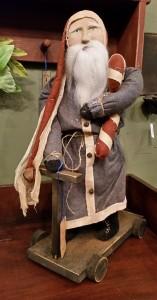 Arnett Santa holding Candy Cane