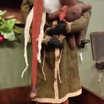 Arnett Santa holding Gingerbread man