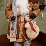Arnett Santa holding Snowman